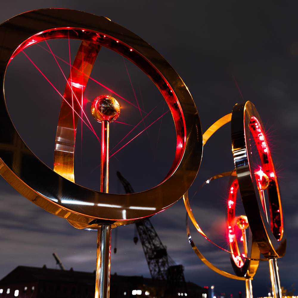 Three armillary laser harps under the sky with different patterns